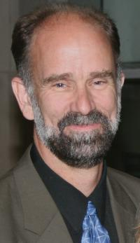 headshot of bearded man