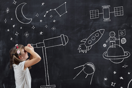 girl looking through chalkboard telescope