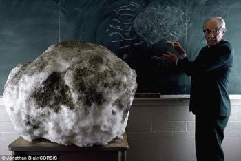man with a giant dirty snowball