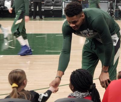 basketball player interacting with child