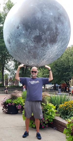 man holding big moon