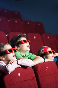 kids with 3d glasses in theater